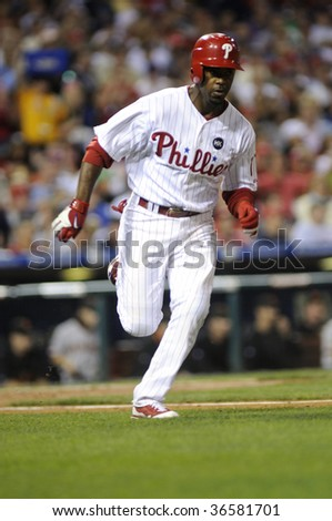PHILADELPHIA - SEPTEMBER 2:  Phillies shortstop Jimmy Rollins runs towards first after making contact September 2, 2009 in Philadelphia. - stock photo