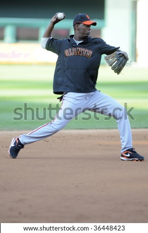 PHILADELPHIA - SEPTEMBER 2: San Francisco Giants shortstop Edgar Renteria throws from short during infield practice September 2, 2009 in Philadelphia.