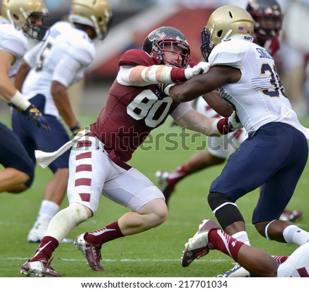 PHILADELPHIA - SEPTEMBER 6: Temple Owls wide receiver Zack Bambary #80 is blocked on kick coverage during a NCAA football game between Temple and Navy September 6, 2014 in Philadelphia.  - stock photo
