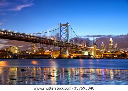 Philadelphia skyline and Ben Franklin Bridge at dusk, United States - stock photo