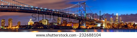 Philadelphia skyline panorama and Ben Franklin Bridge at twilight, US - stock photo