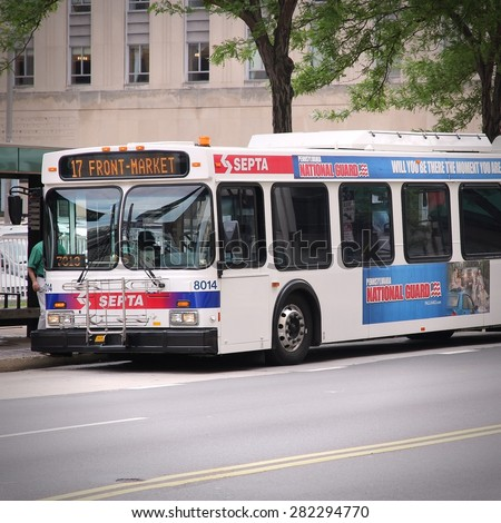 PHILADELPHIA, UNITED STATES - JUNE 11, 2013: People ride SEPTA bus in Philadelphia. SEPTA served almost 321 million rides in 2010. - stock photo