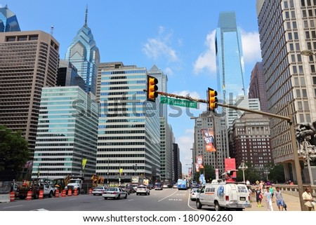 PHILADELPHIA, USA - JUNE 11, 2013: People drive in Philadelphia. As of 2012 Philadelphia is the 5th most populous city in the US with 1,547,607 citizens. - stock photo