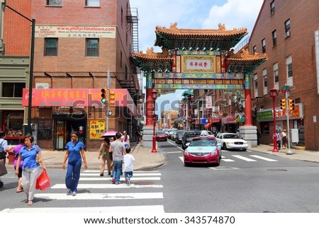 PHILADELPHIA, USA - JUNE 11, 2013: People visit Chinatown in Philadelphia. The Chinatown gate was completed in 1984 and represents partnership with sister city Tianjin (China). - stock photo