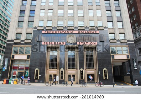 PHILADELPHIA, USA - JUNE 11, 2013: People walk by Pennsylvannia Railroad Suburban Station in Philadelphia. As of 2012 Philadelphia is the 5th most populous city in the US with 1,547,607 citizens. - stock photo