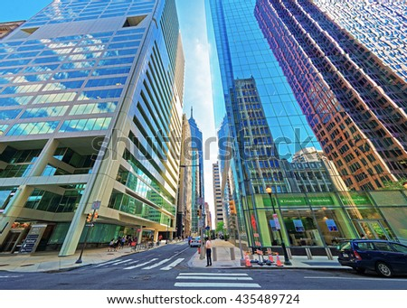 Philadelphia, USA - May 4, 2015: Arch Street view with skyscrapers reflected in glass in the City Center of Philadelphia, Pennsylvania, the USA. It is central business district in Philadelphia. - stock photo