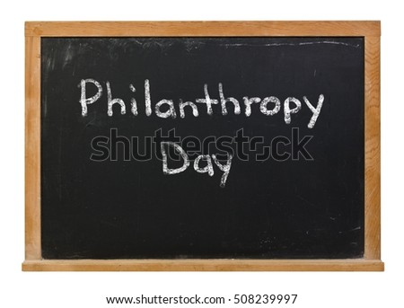 Philanthropy Day written in white chalk on a black chalkboard isolated on white