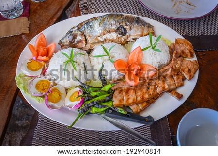 Philippine Lunch Fare - Rice, Milkfish, Salted Eggs, Pork - stock photo