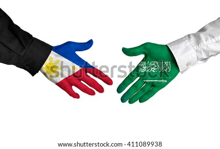 Philippines and Saudi Arabia leaders shaking hands on a deal agreement - stock photo