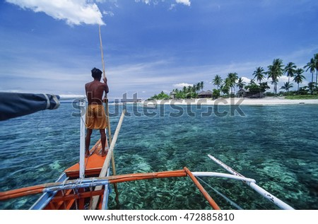 PHILIPPINES, Balicasag Island (Bohol), fisherman on his banca (local wooden fishing boat) - FILM SCAN