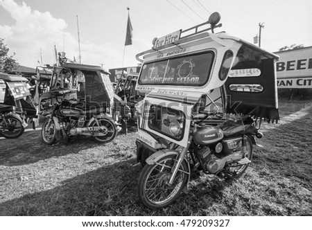 PHILIPPINES, Bohol Island; 18 March 2000, local taxi cabs (tuk-tuk) near the airport - EDITORIAL (FILM SCAN)