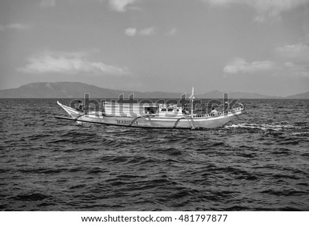 PHILIPPINES, Bohol; 20 March 2001, fishermen on a local wooden fishing boat - EDITORIAL (FILM SCAN)
