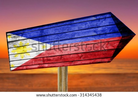 Philippines Flag wooden sign on beach background