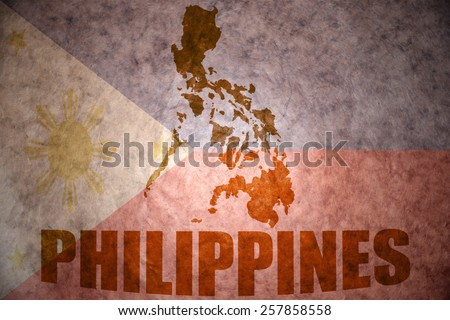 philippines map on a vintage philippine flag background - stock photo