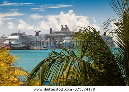 PHILIPSBURG, ST.MAARTEN - JAN. 19, 2011:  Cruise ships anchored in the port of Philipsburg in St. Maarten.  In order for the largest ship to enter the port, sand had to be dredged out of the harbor. - stock photo