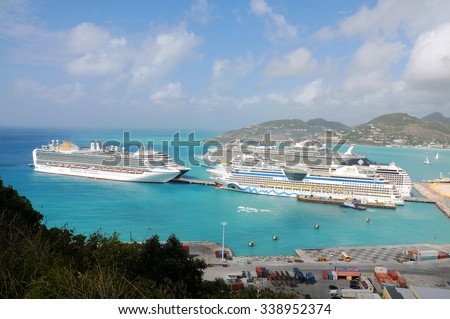 PHILIPSBURG, ST. MAARTEN - JAN. 14: Cruise ships docked in St. Maarten on Jan. 14, 2011. St. Maarten is unique in that France and the Netherlands have amicably shared the island for over 300 years. - stock photo