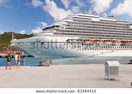 PHILIPSBURG, ST. MAARTEN - JAN. 19:  Passengers walk to their ship docked in St. Maarten on Jan. 19, 2011.  It's unique in that half of the island is owned by the Dutch, the other half by the French. - stock photo