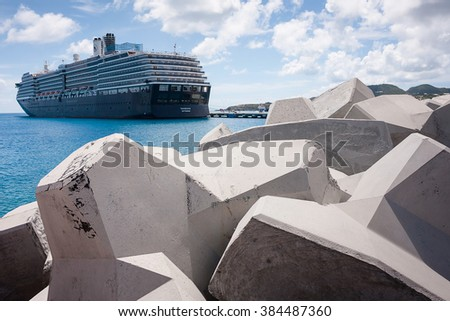 PHILISBURG,ST. MARTEEN - APRIL 25,2011: Noordam cruise ship is docked at St. Marteen island harbor. Concrete spurs on the foreground. - stock photo