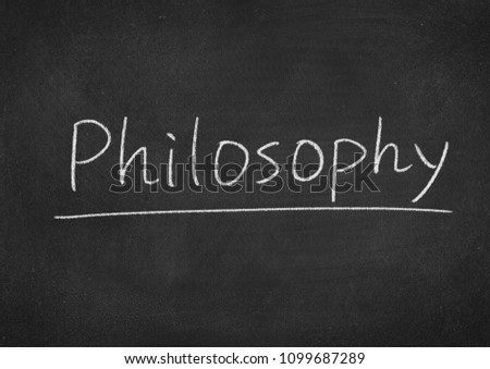 philosophy concept word on a blackboard background