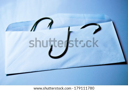 phishing / fish hook in an envelope / email phishing / spam mail / computer threats - stock photo