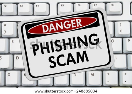 Phishing Scam Danger Sign,  A red and white sign with the words Phishing Scam on a keyboard - stock photo