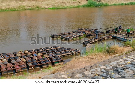 PHITSANULOK,THAILAND - APRIL 6, 2016 the raft  made of iron tank in river Wat Phra Sri Rattana Mahathat  April 6, 2016 in phitsnulok,Thailand.