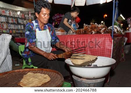 PHITSANULOK, THAILAND-JUNE 21: An unidentified Thai people sells food on night market walk street on June 21,2014 in Phitsanulok, Thailand - stock photo