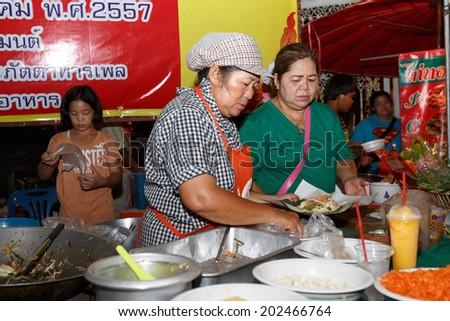 PHITSANULOK, THAILAND-JUNE 21: An unidentified Thai people sells pad Thai on night market walk street on June 21,2014 in Phitsanulok, Thailand - stock photo