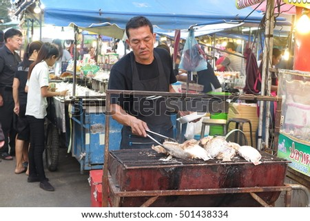 PHITSANULOK, THAILAND - OCTOBER 18, 2016 : Lots of food, dessert, fruit at Street food market on October 18, 2016 in Phitsanulok, Thailand