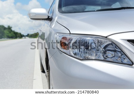 PHITSANULOK, THAILAND - SEPTEMBER 1: Front Part of Toyota Altis on the Road, on September 1, 2014.Toyota is one of the famous car brand that can sell in Thailand. - stock photo