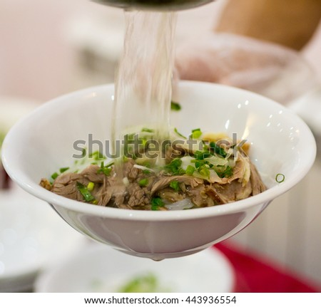 Pho bo, Vietnamese food, rice noodle soup with sliced beef - stock photo
