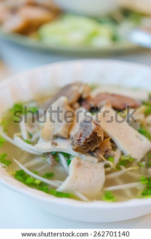 Pho Bo - Vietnamese fresh rice noodle soup with beef, herbs and vegetable - stock photo