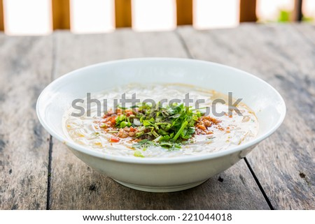 Pho Lao style noodle soup on table - stock photo