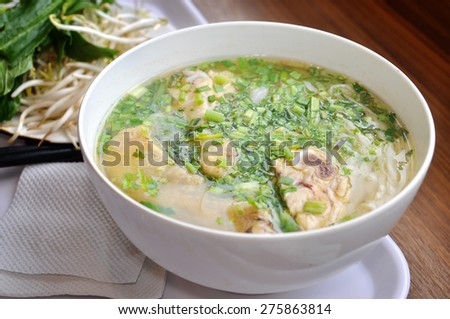 Pho or Vietnamese rice vermicelli noodle with beef or chicken on the table - stock photo