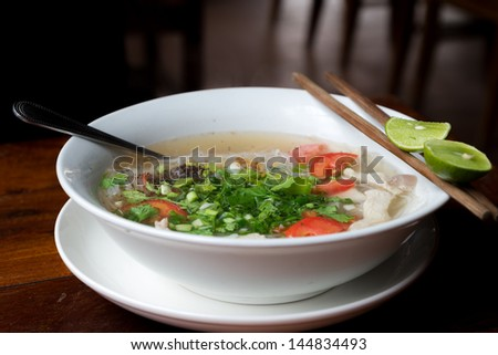 Pho soup as it is served in south east asia. With fresh spices and herbs.