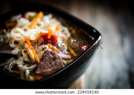 Pho soup on wooden background - stock photo