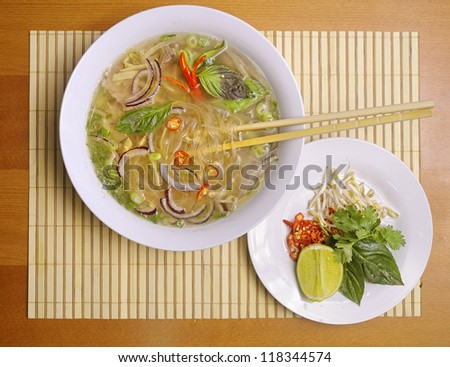 Pho soup with lime and peppers