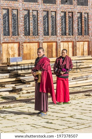 PHOBJIKHA VALLEY, BHUTAN - MARCH 03, 2014: two monks at gangtey monastery, a well known monastery in Phobjikha valley, Bhutan