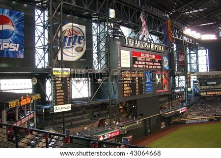 PHOENIX - APRIL 29 : Giant scoreboard and domed roof of Chase Field in Arizona, before an Arizona Diamondbacks and San Francisco Giants baseball game on April 29, 2007 in Phoenix. - stock photo