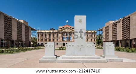 PHOENIX, ARIZONA - AUGUST 6: Monument to Arizona's War Heroes in front of the Arizona State Capitol building on August 6, 2014 in Phoenix, Arizona - stock photo
