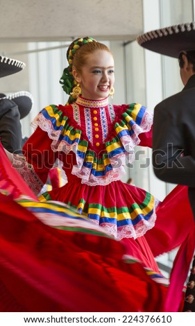 Phoenix, Arizona - July 6, 2014: Unidentified Traditional dancers at a public exhibition at the Phoenix Burton Barr Central Public Library in honor of Frida Kahlo's Birthday.  - stock photo