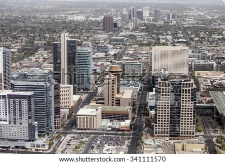 PHOENIX, ARIZONA- MARCH 13, 2014: A low aerial flyover of the downtown business district of Phoenix, Arizona. - stock photo