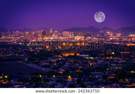 Phoenix Arizona Skyline at Night. Full Moon Over Phoenix, Arizona, United States. - stock photo
