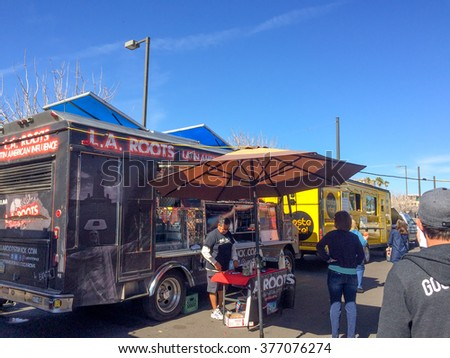 PHOENIX, AZ - FEBRUARY 5, 2016: People checking L.A. Roots Latin American Influence food truck with hot and spicy meals at designated spot in downtown of Phoenix, AZ