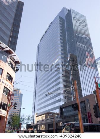 PHOENIX, AZ - FEBRUARY 8, 2016: Shiny tower of Western Alliance Bank covered with advertisements at Washington Street in downtown of Phoenix, AZ - stock photo