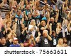 PHOENIX, AZ - MARCH 12: Arizona Rattlers fans celebrate a touchdown during Arena Football League action against the Jacksonville Sharks at U.S. Airways Center on March 12, 2011 in Phoenix AZ. - stock photo