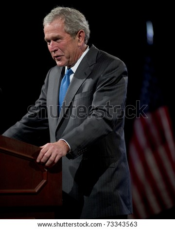 PHOENIX, AZ - MARCH 16: Former President George W. Bush speaks at the Phoenix Convention Center on  March 16, 2011 in Phoenix, AZ.