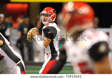 PHOENIX, AZ - MARCH 12:Jacksonville Sharks Aaron Garcia(8) drops back to pass during Arena Football League action against the Arizona Rattlers at U.S. Airways Center on March 12, 2011 in Phoenix AZ.