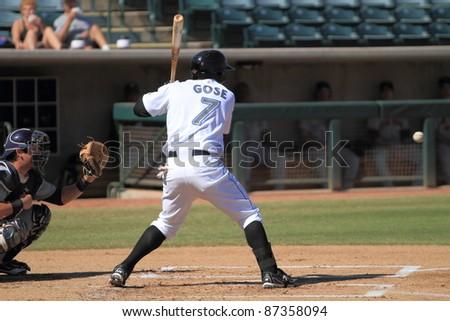 PHOENIX, AZ - OCTOBER 19: Anthony Gose, a Toronto Blue Jays prospect, bats for the Phoenix Desert Dogs in an Arizona Fall League game on Oct. 19, 2011 at Phoenix Municipal Stadium, Phoenix, AZ. Gose drove in 3 runs. - stock photo