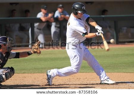 PHOENIX, AZ - OCTOBER 19: Dusty Coleman, an Oakland A's infield prospect, bats for the Phoenix Desert Dogs in the Arizona Fall League on Oct. 19, 2011 at Phoenix Municipal Stadium, Phoenix, AZ. Coleman went 0-for-4. - stock photo